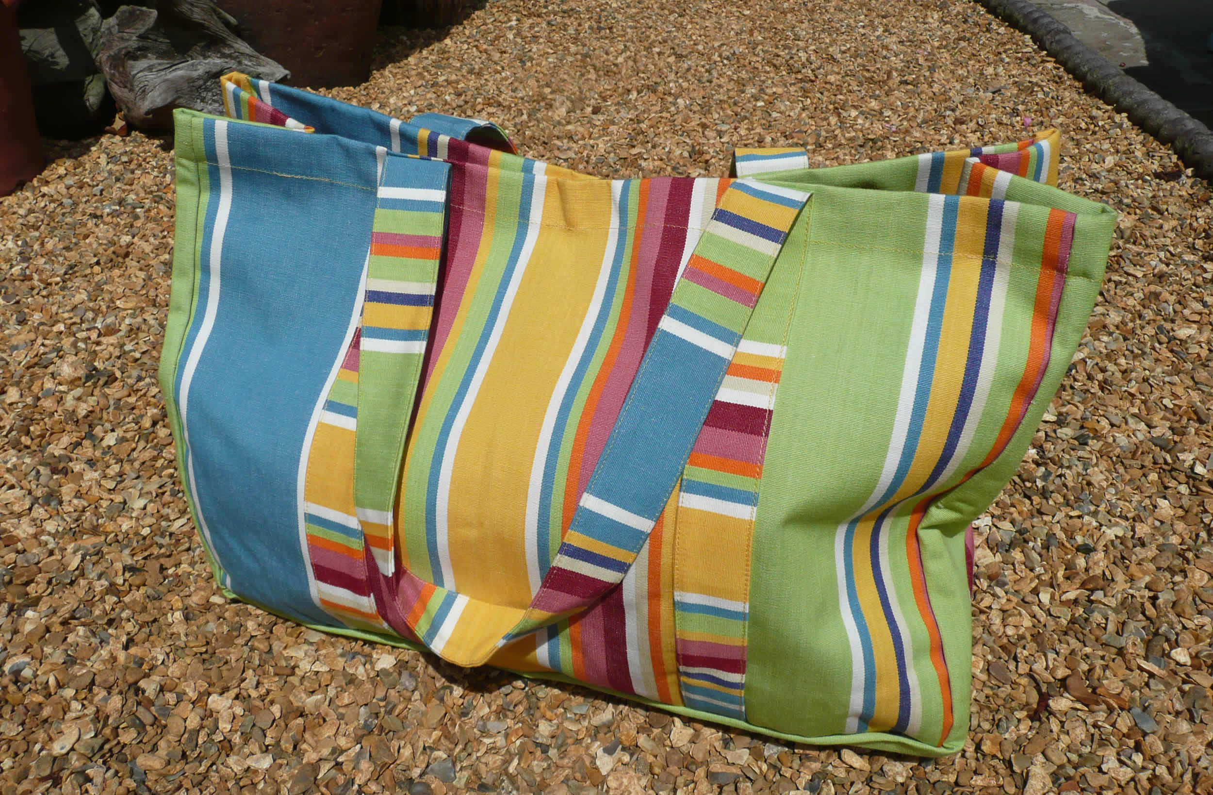 Stylish Yellow Extra Large Beach Bags With Colourful Stripes Of Pale Green And Sky Blue A Waterproof Zipped Compartment