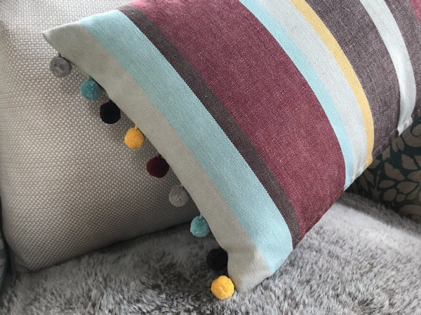 Earth Tones Striped Oblong Cushions with Bobble Fringe