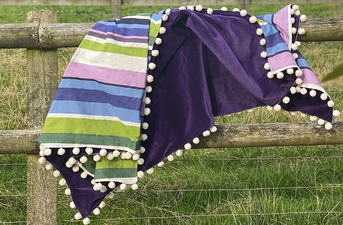 Reversible Purple Striped Velvet Throws Trimmed with White Pom Poms
