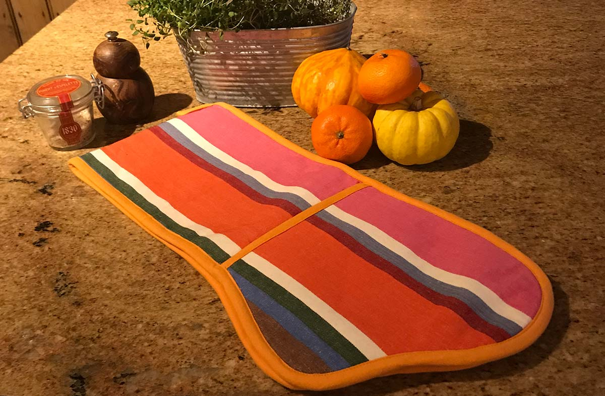 Tangerine, pink, blue and brown stripey oven gloves